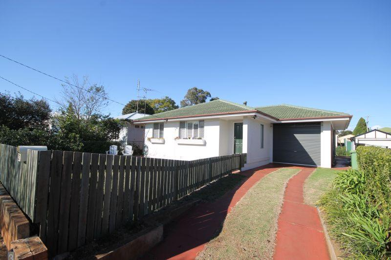 NEWTOWN. NEAT HOME WITH 4 CAR ACCOMMODATION