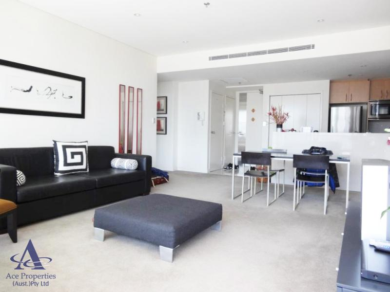 Furnished modern 2-bedroom Apartment high above on the 49 floor in World Tower!